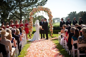 Bride and groom standing at altar with wedding party