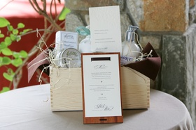 Wood box filled with toiletries for out-of-town wedding guests