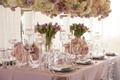 Wedding reception table inspiration purple tulips low hydrangea rose flowers tall matching flowers