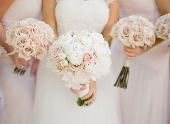 Bride's bouquet of white and light pink flowers and bridesmaids' bouquets of pale pink roses