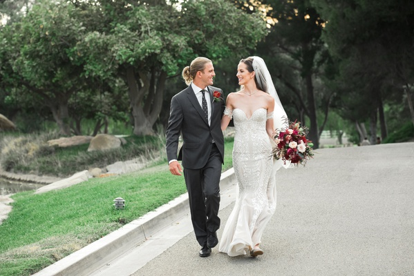 bride in pallas couture mermaid wedding dress, groom with man bun in charcoal suit and polka dotted