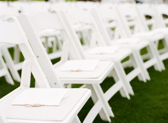 Ribbon-tied wedding programs on each chair