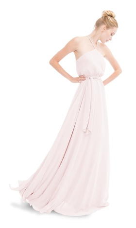 Spaghetti strap halter gown with a full skirt and optional tie at waist.