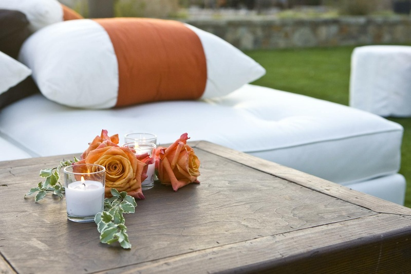 Small centerpiece with orange roses and candles