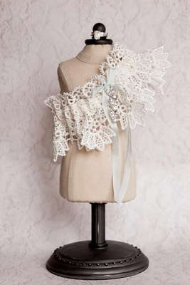 Wedding day garter on mini dress stand with light blue ribbon