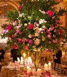 Wedding reception round table with tall tree centerpiece pink and white flowers amaranthus branches