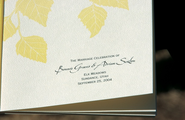 Ceremony program with yellow autumn leaves