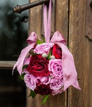 Round bouquet pomander for flower girl with pink and red roses