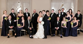 Bridesmaids and groomsmen in chairs