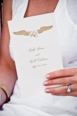 Ceremony booklet with wing monogram motif
