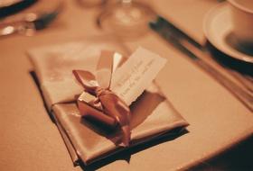 Gold box filled with Godiva chocolate starfish
