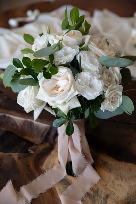 wedding bouquet white rose lisianthus flowers greenery frayed blush pink ribbon torn edge ripped