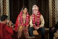 bride and groom smile during hindu wedding ceremony