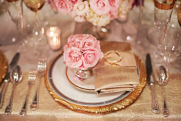 Wedding reception shoot with gold plate and pink flowers