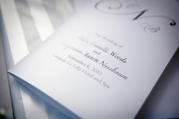 Wedding ceremony program with white paper and purple font