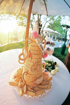 Tall coiled wedding cake with icing and props