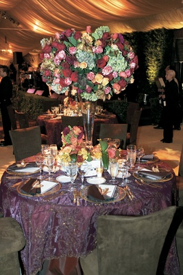 Purple wedding reception table with fall centerpiece