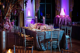 Grey crinkle linens at wedding table with floating candles