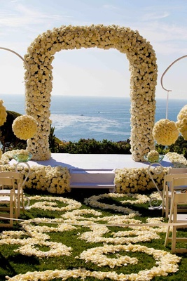 Oceanview wedding ceremony with hundreds of white and ivory roses