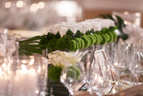 Wedding reception centerpiece low long arrangement green mum greenery white rose flowers