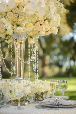 White and ivory centerpiece with hanging crystals