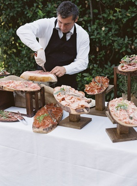 wedding reception cocktail hour destination wedding meat carver prosciutto and salami italy