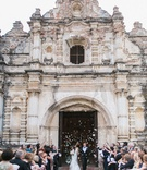 bride and groom leaving church doors guatemala destination wedding flower petal toss