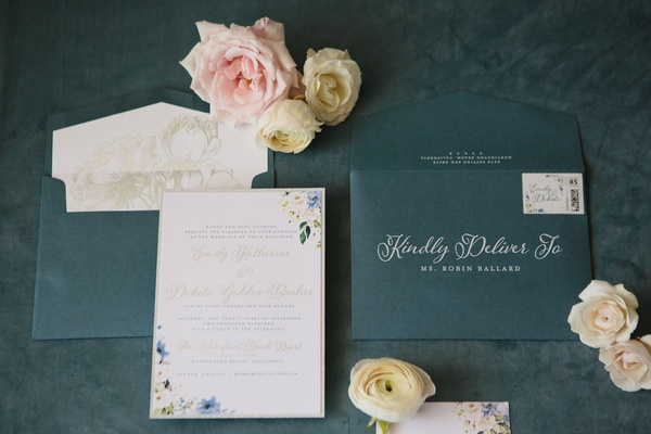wedding invitation with flower motif gold details white calligraphy blue stationery envelope