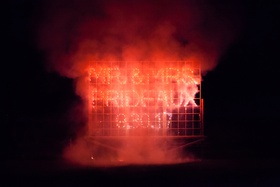 firework sign with newlyweds' names and wedding date