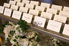 Black tie wedding simple sophisticated escort cards calligraphy script tables spelled out