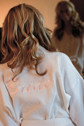 Back of white robe with pink bride embroidery