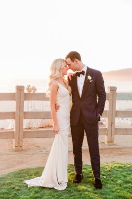 bride in v neck beaded wedding dress long blonde curled hair groom tuxedo palisades park california