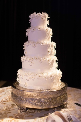 5 tier white classic cake modeled after brides liancarlo wedding gown flowers dessert italian