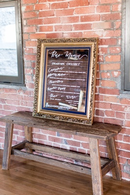 Wedding reception bar menu on mirror gold frame beer wine tequila calligraphy signature cocktails