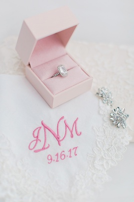 radiant cut diamond halo engagement ring, lace handkerchief with pink monogram