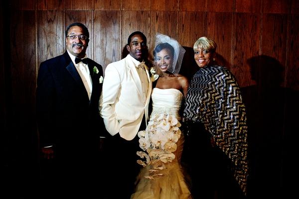 Jarett Dillard with bride's parents at wedding