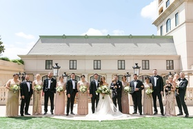 bride in stella york, mismatched bridesmaids in gold and champagne hues, groomsmen in tuxedos
