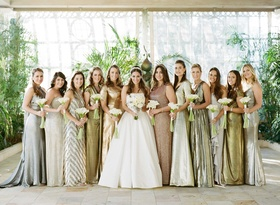 a-line strapless Reem acra wedding dress with bridesmaids in metallic silver gold mismatched dresses