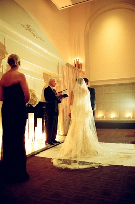 Ivory aisle runner and understated ballroom decor