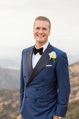 Groom in tuxedo navy double breasted tuxedo jacket black lapel bow tie pocket square