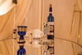 blue and gold cup and wine bottle, silver kiddush cup, jewish wedding