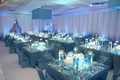 ballroom with white drapery and blue tables