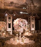 wedding reception at the pierre new york glass centerpiece pink rose white orchid tulip glassware