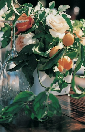 Short floral centerpieces on wooden tables