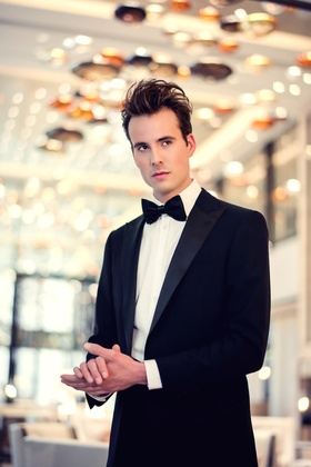 Model in black and white tuxedo with Ralph Lauren suit jacket