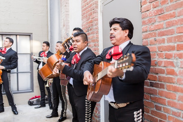 Wedding ceremony outdoor mariachi band in uniform brick wall performing outdoors urban venue