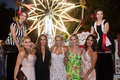 "CJ ""Lana"" Perry with famous wedding guests at circus theme wedding ferris wheel and circus performer"