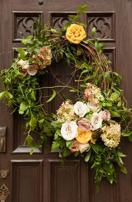 Wedding ceremony decor outside door decoration wreath with greenery white pink yellow orange flowers