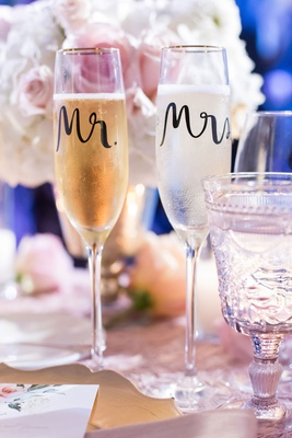 wedding reception table sweetheart table with mr and mrs calligraphy gold rim champagne flutes glass