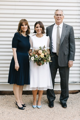 bride in short sleeve givenchy wedding dress short hair down fall bouquet mother in navy blue dress